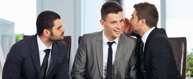 businessmen-gossiping-in-the-office