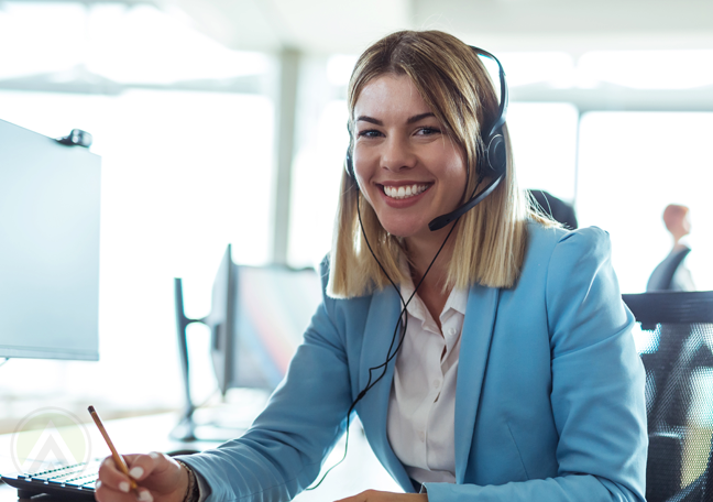 brightly smiling female call center agent at work