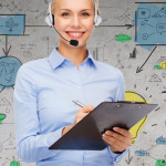 female-call-center-manager-holding-clipboard-checking-mentrics--Open-Access-BPO-