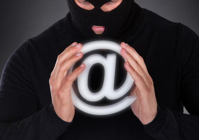 hacker-in-ski-mask-holding-email