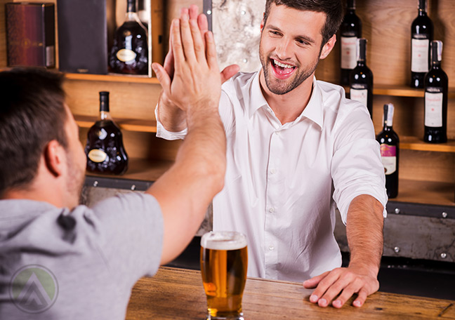 Bartender-giving-a-high-five-to-a-customer-great-customer-experience