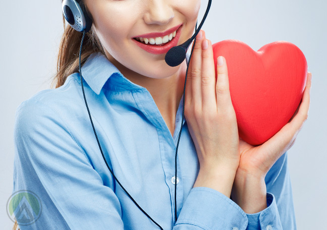 female-call-center-agent-holding-red-heart