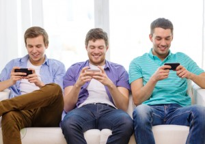 male-millennials-busy-on-smartphones