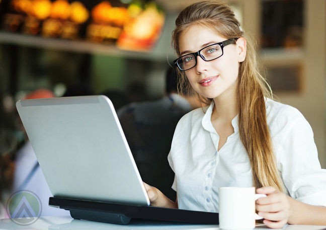 pretty-female-using-laptop-and-having-coffee