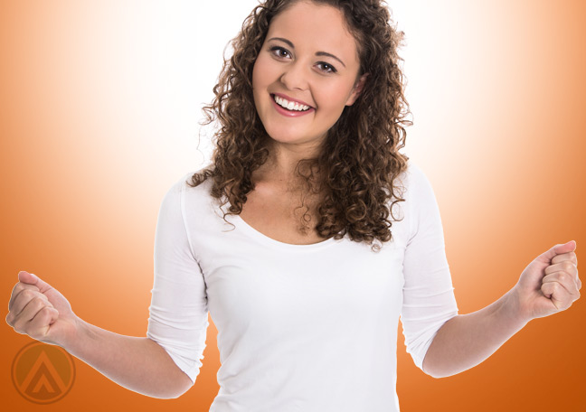 smiling-female-in-orange-background