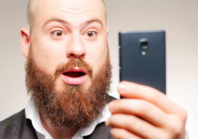 bearded-man-surprised-at-smartphone