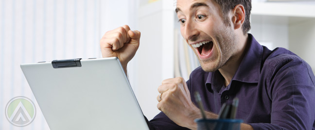 excited-businessman-in-purple-shirt-with-laptop