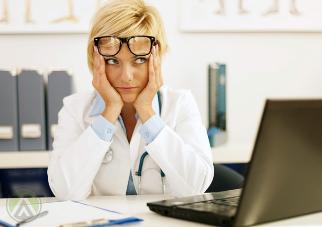 female-medical-practitioner-doctor-in-front-of-laptop
