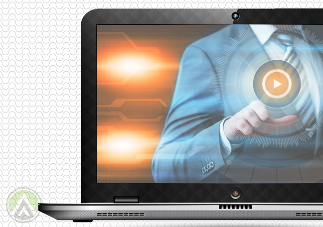 laptop-with-screen-showing-businessman-pushing-play-button-on-video
