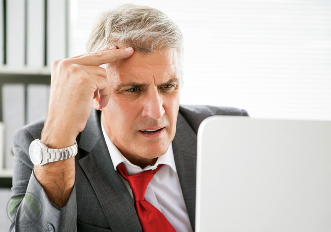 middle-aged-businessman-confused-laptop