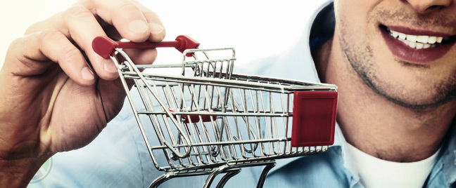 smiling-male-business-executive-holding-smart-shopping-cart