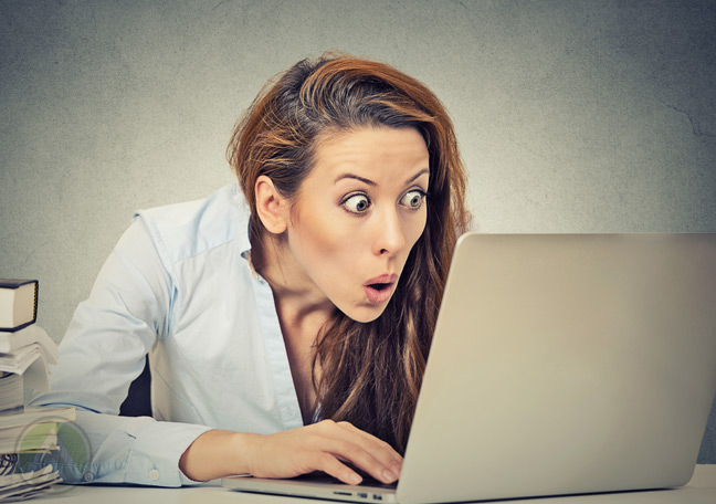 startled-female-employee-staring-at-laptop