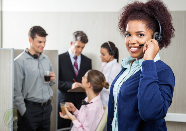 female-african-american-call-center-agent-with-customer-service-coworkers-in-the-back