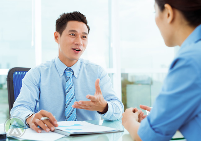 male-businessman-interviewing-job-applicant