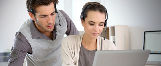 male-quality-assurance-specialist-listening-a-call-with-female-customer-service-agent