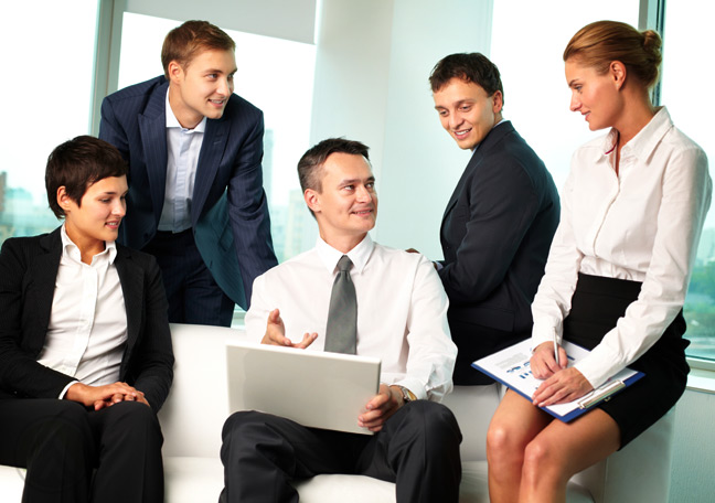 business-team-in-discussion-with-boss-with-laptop