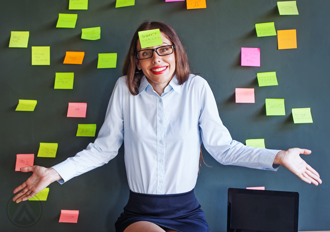 female-executive-covered-with-post-it-notes-shrugging-shoulder-apologetically