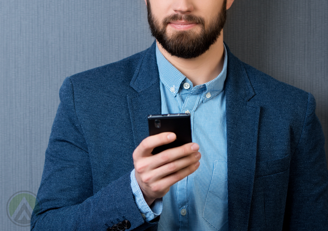 bearded-businessman-using-smartphone