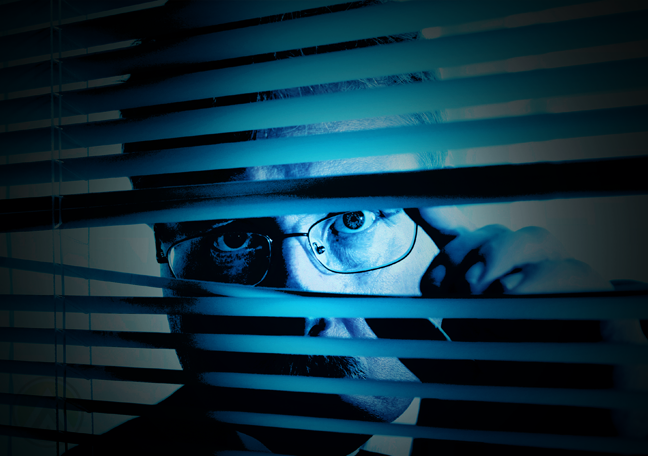 businessman-peeking-through-window-blinds