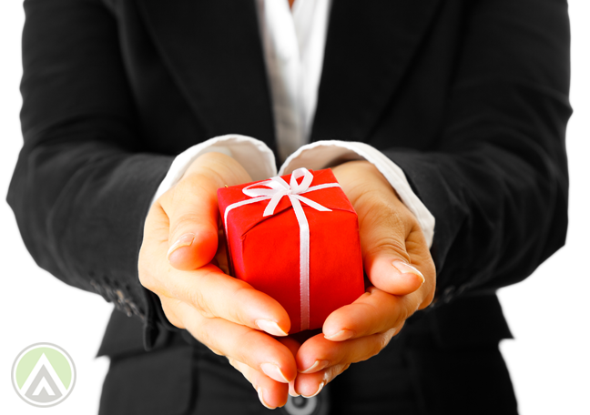 female-employee-holding-out-hand-with-red-gift-box