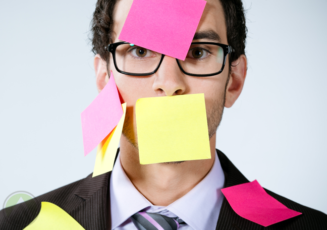 businessman-in-glasses-wearing-covered-in-postit-notes