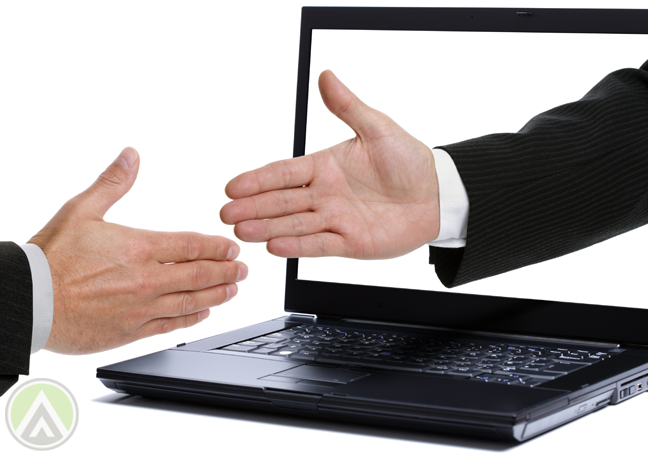 businessmen-shaking-hands-through-laptop-monitor