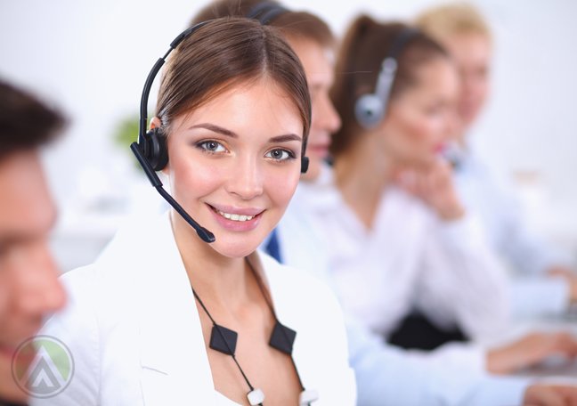 calm-female-call-center-agent-in-the-middle-of-busy-coworkers