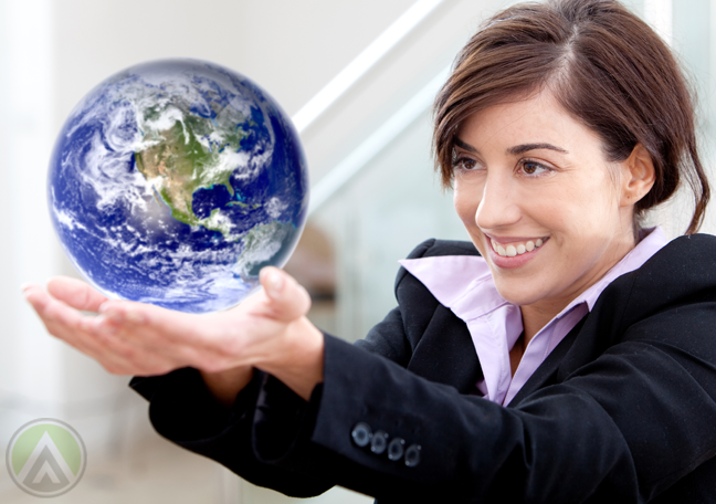 smiling-business-woman-holding-up-globe