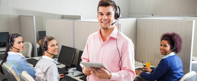 smiling-call-center-team-leader-with-diverse-customer-support-tearm