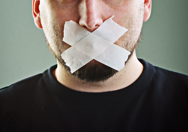 bearded-man-with-tapes-covering-mouth