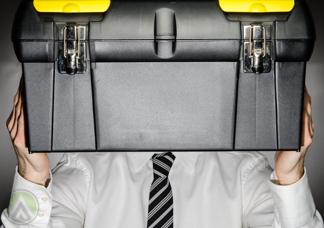 businessman-employee-carrying-tool-box-in-front-of-head
