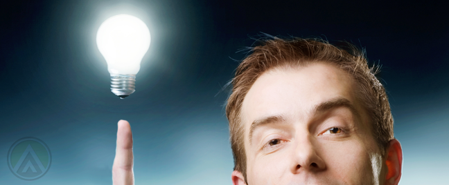 businessman-with-bright-idea-pointing-to-light-bulb