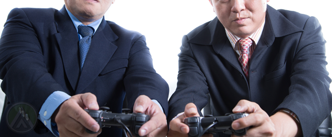 businessmen-playing-video-games-game-controller