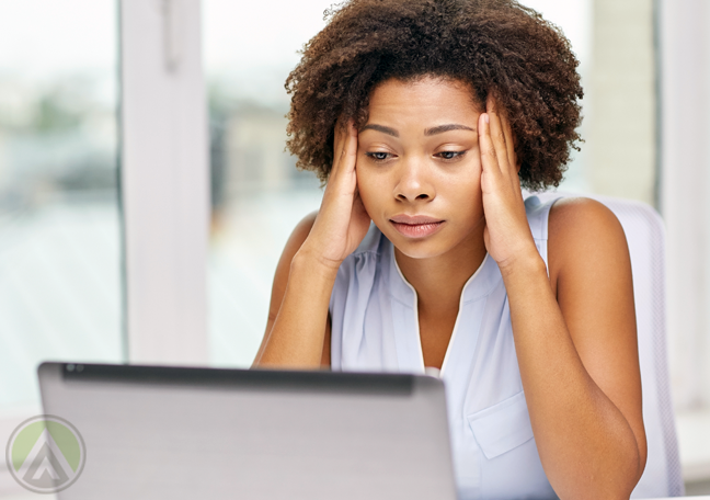 female-business-employee-disappointed-at-laptop