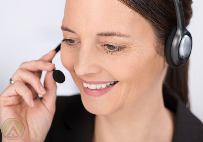 female-call-center-agent-listening-closely-to-call