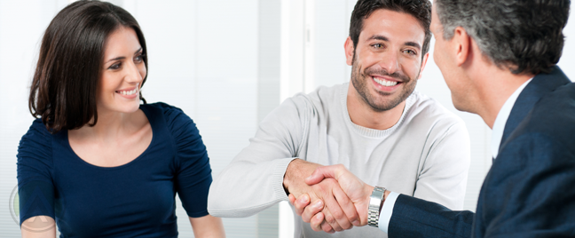 happy-couple-shaking-hands-businessman