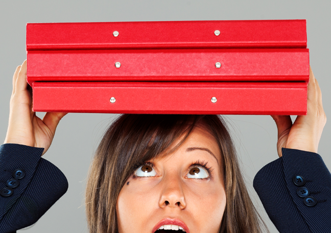 surprised-female-business-employee-carrying-red-folder-over-head