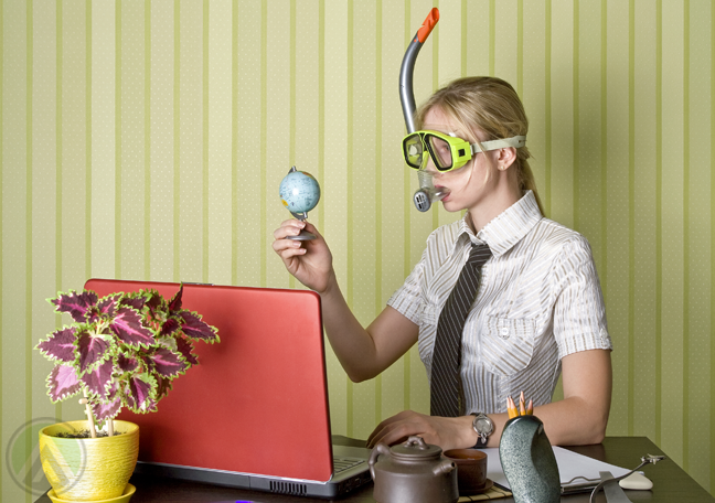busy-female-office-staff-wearing-goggles-holding-small-globe