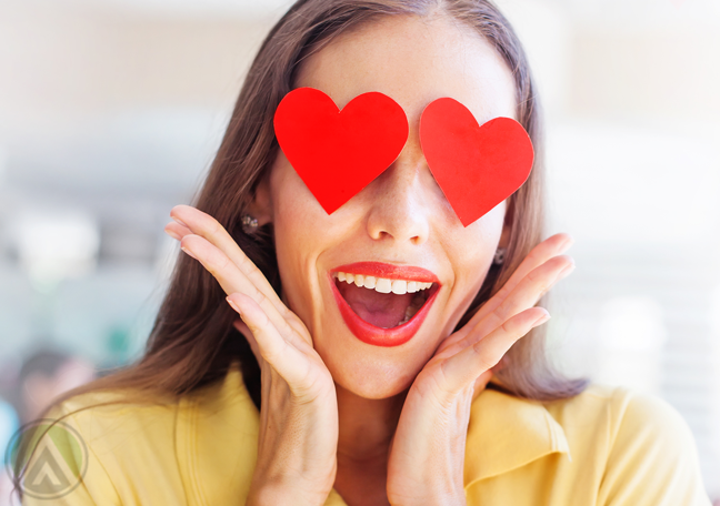 delighted-woman-in-yellow-with-hearts-for-eyes