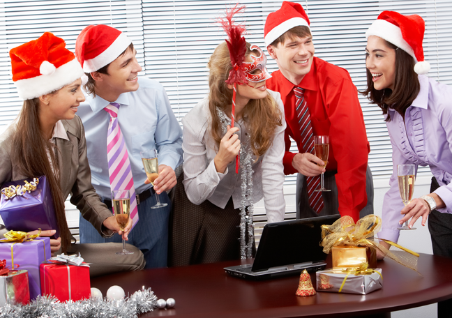 diverse-business-team-office-party-santa-hat