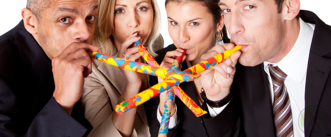 diverse-team-celebrating-holiday-blowing-colorful-party-kazoos