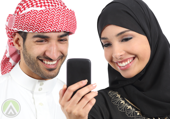 male-female-arabic-smiling-enjoying-smartphone-social-media