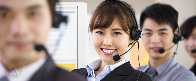 smiling-Asian-Filipino-call-center-agent-with-customer-service-coworkers