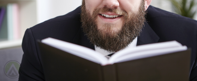 smiling-matured-businessman-reading-book