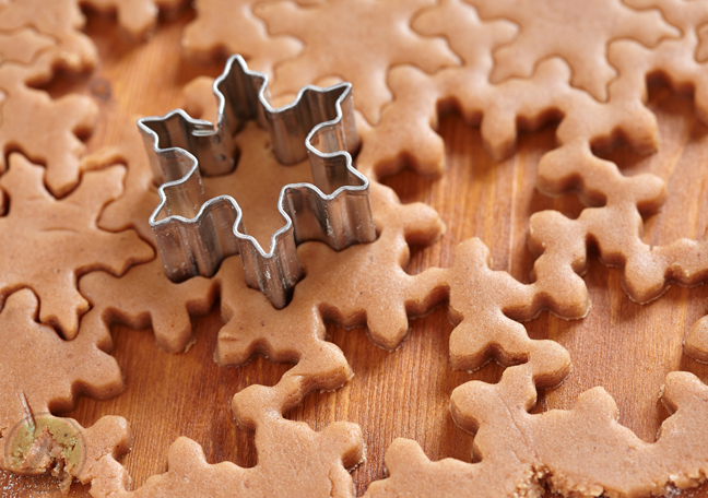 snowflake-cookie-cutter-over-gingerbread-dough