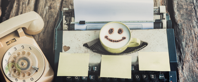 typewriter-landline-telephone-with-smiley-in-latte