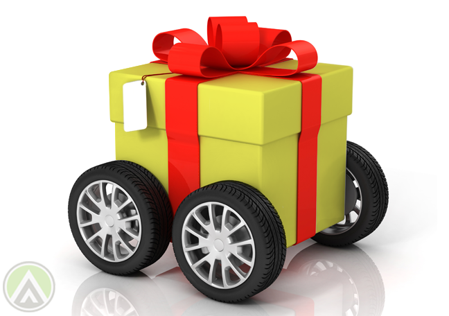 yellow-gift-with-red-ribbons-on-wheels