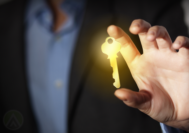 businessman-in-the-dark-holding-glowing-key