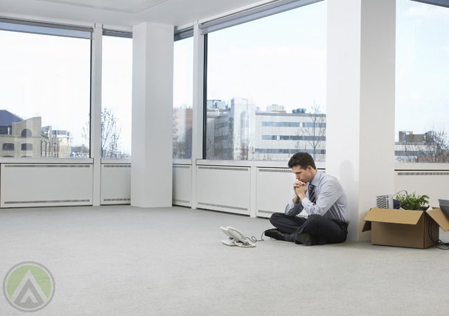 empty-white-office-with-employee-sitting-on-floor-with-telephone