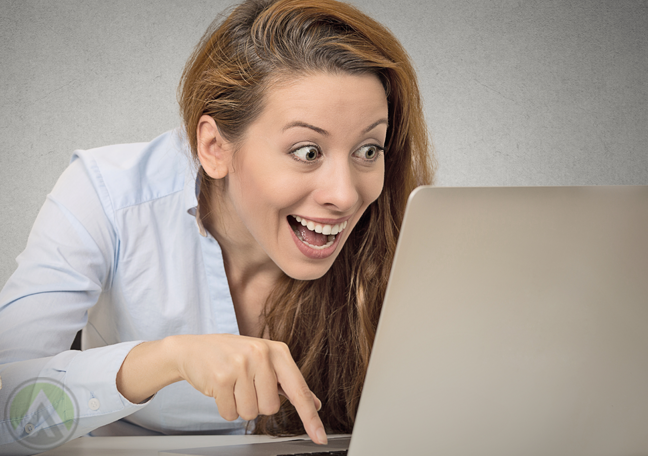 excited-woman-looking-at-laptop